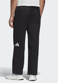 adidas Performance - ADIDAS ATHLETICS PACK TWILL TROUSERS - Kangashousut - black - 1