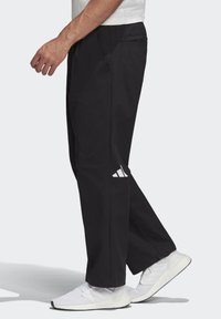 adidas Performance - ADIDAS ATHLETICS PACK TWILL TROUSERS - Kangashousut - black
