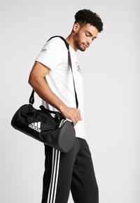 adidas Performance - Sports bag - black/grefou/white - 1