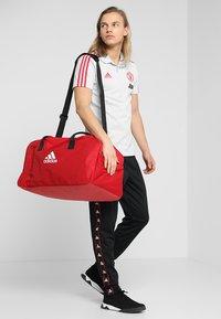 adidas Performance - TIRO DU  - Sportväska - power red/white - 1