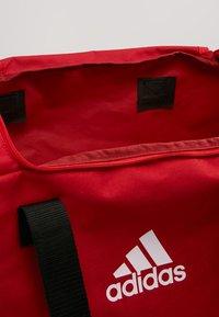 adidas Performance - TIRO DU  - Sportväska - power red/white - 4