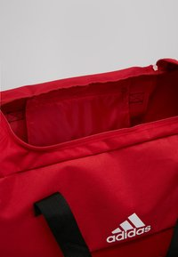 adidas Performance - TIRO DU - Sports bag - power red/white - 4