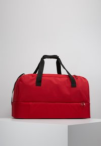 adidas Performance - TIRO DU - Sports bag - power red/white - 2