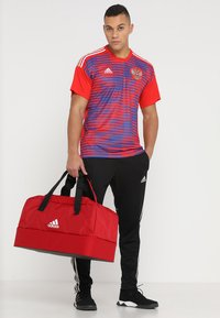 adidas Performance - TIRO DU - Sports bag - power red/white - 1