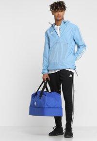 adidas Performance - TIRO DU - Bolsa de deporte - bold blue/white - 1