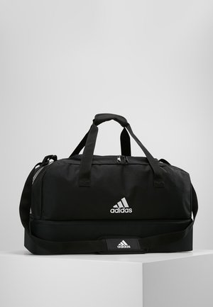 TIRO DU - Sports bag - black/white