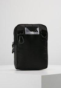 adidas Performance - PARKHOOD  - Schoudertas - black/black/white - 2