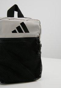 adidas Performance - PARKHOOD  - Taška spříčným popruhem - black/raw white/raw white - 7