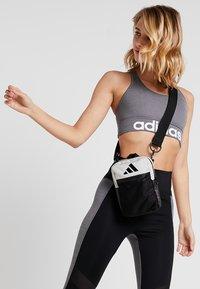 adidas Performance - PARKHOOD  - Taška spříčným popruhem - black/raw white/raw white - 5
