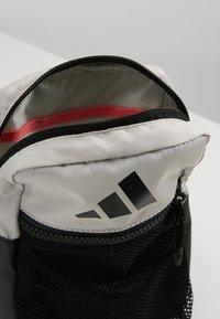 adidas Performance - PARKHOOD  - Taška spříčným popruhem - black/raw white/raw white - 4