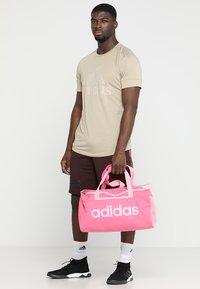 adidas Performance - LIN CORE  - Sports bag - semi solar pink/true pink - 1