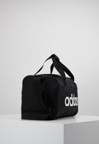 adidas Performance - LIN CORE  - Sports bag - black/white - 3