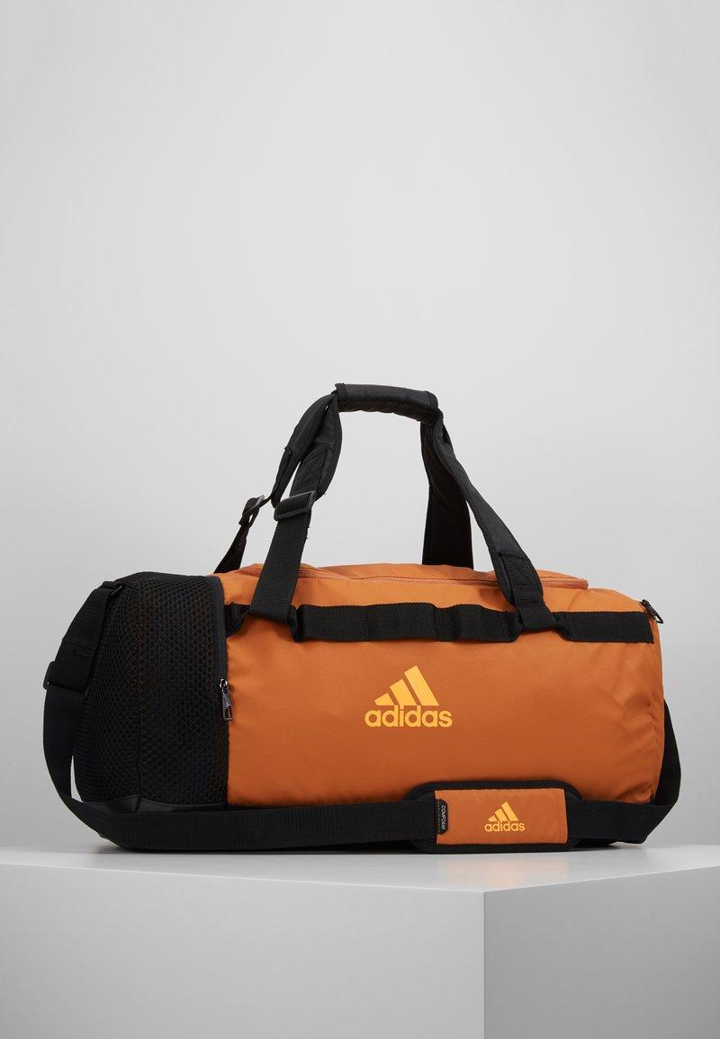 adidas Performance - Sportovní taška - tech copper/black/flash orange