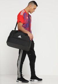 adidas Performance - Sports bag - black/white - 1