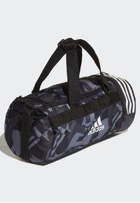 adidas Performance - 3-STRIPES CONVERTIBLE GRAPHIC DUFFEL BAG SMALL - Drawstring sports bag - black/white - 3
