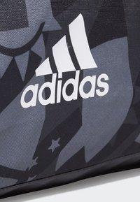 adidas Performance - 3-STRIPES CONVERTIBLE GRAPHIC DUFFEL BAG SMALL - Drawstring sports bag - black/white - 4