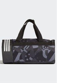adidas Performance - 3-STRIPES CONVERTIBLE GRAPHIC DUFFEL BAG SMALL - Drawstring sports bag - black/white - 2