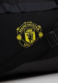 adidas Performance - MANCHESTER UNITED FC - Sports bag - black/solar grey/bright yellow - 8
