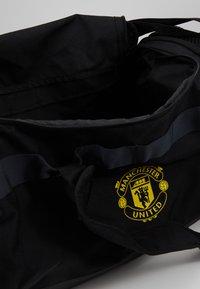 adidas Performance - MANCHESTER UNITED FC - Sports bag - black/solar grey/bright yellow - 4