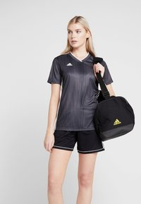 adidas Performance - MANCHESTER UNITED FC - Sports bag - black/solar grey/bright yellow - 6