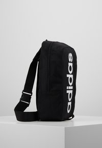 adidas Performance - LIN CORE CROSS - Across body bag - black/white - 3
