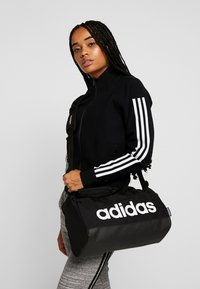 adidas Performance - LIN DUFFLE XS - Sports bag - black/white - 5