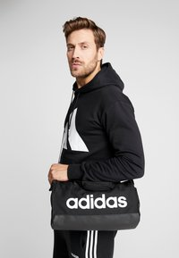 adidas Performance - LIN DUFFLE XS - Sports bag - black/white - 1