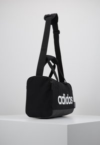 adidas Performance - LIN DUFFLE XS - Sports bag - black/white - 3