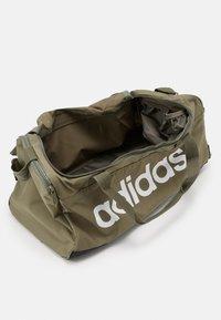 adidas Performance - ESSENTIALS LINEAR SPORT DUFFEL BAG UNISEX - Sports bag - green - 3