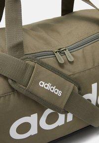 adidas Performance - ESSENTIALS LINEAR SPORT DUFFEL BAG UNISEX - Sports bag - green - 4