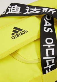 adidas Performance - 4ATHLTS ESSENTIALS 3STRIPES SPORT DUFFEL BAG - Sportovní taška - shock yellow/white/black - 8