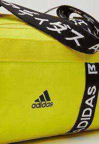 adidas Performance - 4ATHLTS ESSENTIALS 3STRIPES SPORT DUFFEL BAG - Sportovní taška - shock yellow/white/black - 5