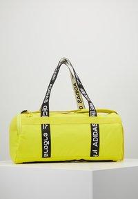 adidas Performance - 4ATHLTS ESSENTIALS 3STRIPES SPORT DUFFEL BAG - Sportovní taška - shock yellow/white/black - 2