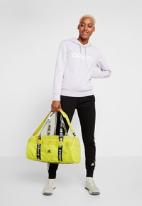 adidas Performance - 4ATHLTS ESSENTIALS 3STRIPES SPORT DUFFEL BAG - Sportovní taška - shock yellow/white/black - 1