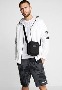 adidas Performance - Across body bag - black/white - 1