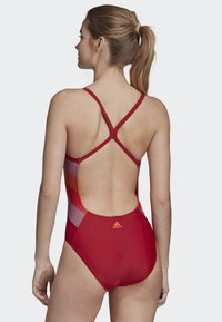 adidas Performance - ATHLY LIGHT GRAPHIC SWIMSUIT - Swimsuit - red - 1
