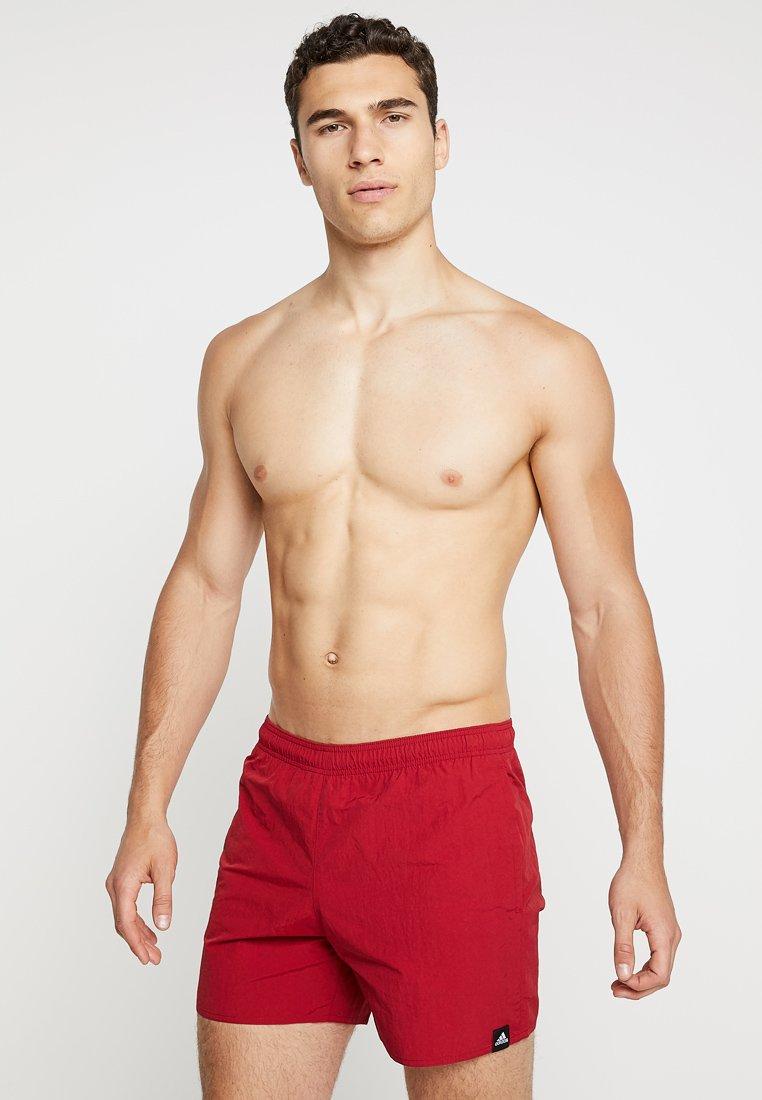 adidas Performance - SOLID  - Swimming shorts - actmar