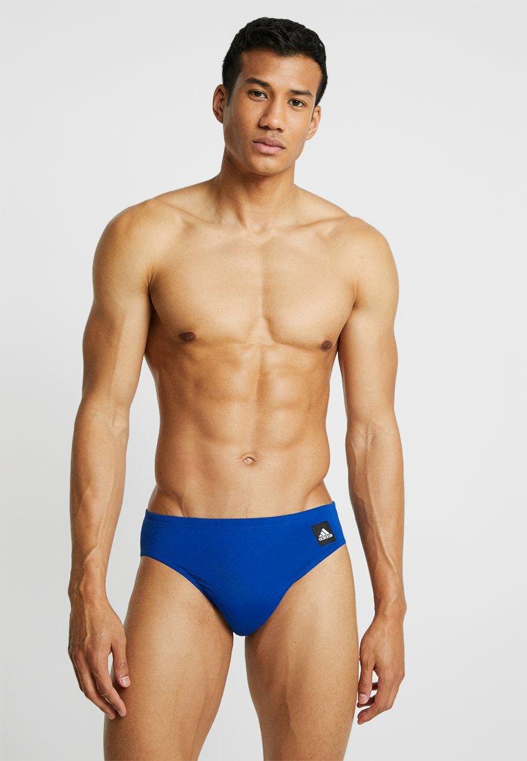 adidas Performance - PRO SOLID - Swimming shorts - croyal/white