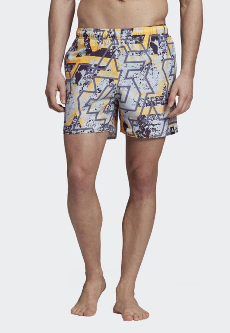 adidas Performance - STORY SWIM SHORTS - Swimming shorts - yellow
