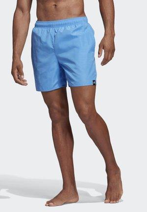 SOLID SWIM SHORTS - Swimming shorts - blue