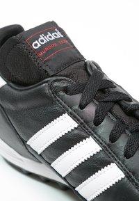 adidas Performance - MUNDIAL TEAM - Astro turf trainers - black/running red/white - 5