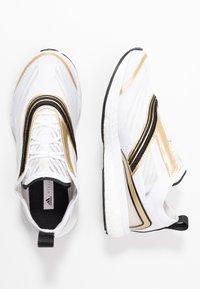 adidas by Stella McCartney - BOSTON S. - Laufschuh Neutral - footwear white/golden butter - 1