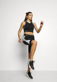 adidas by Stella McCartney - RUN CROP - Sports shirt - black/visblu - 1
