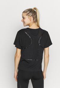 adidas by Stella McCartney - LOOSE TEE - T-shirt print - black - 2