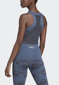 adidas by Stella McCartney - ESSENTIALS SEAMLESS TANK TOP - Linne - blue - 1
