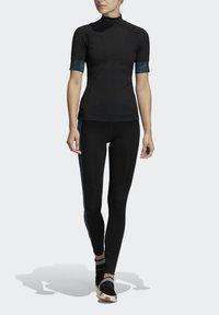 adidas by Stella McCartney - HEAT.RDY FITTED T-SHIRT - Print T-shirt - black - 0