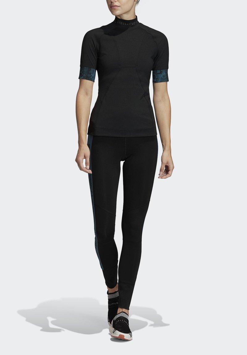 adidas by Stella McCartney - HEAT.RDY FITTED T-SHIRT - Print T-shirt - black