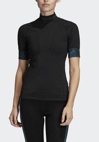 adidas by Stella McCartney - HEAT.RDY FITTED T-SHIRT - Print T-shirt - black - 1