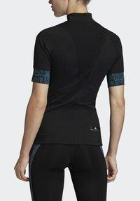 adidas by Stella McCartney - HEAT.RDY FITTED T-SHIRT - Print T-shirt - black - 2