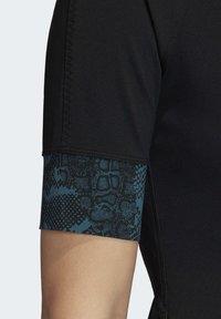 adidas by Stella McCartney - HEAT.RDY FITTED T-SHIRT - Print T-shirt - black - 6